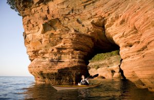 Woman Sea Kayaking in Apostle Islands.